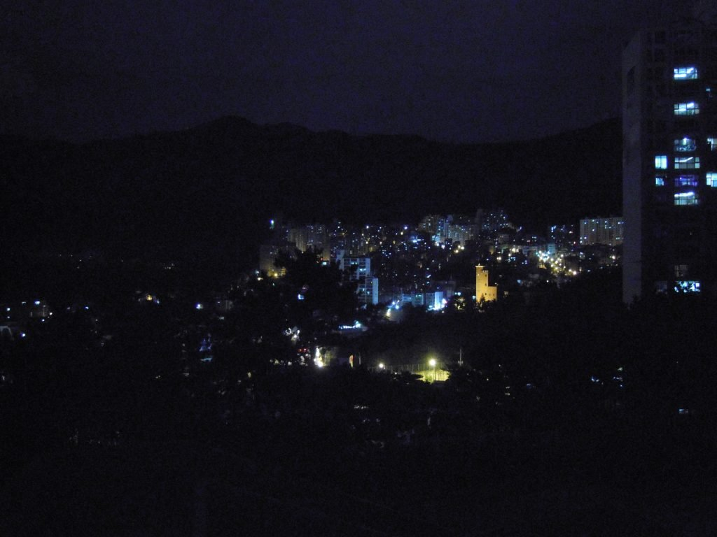 Busan at night on a hill.